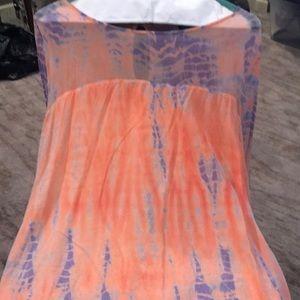 Super cute 100% silk shirt in purple and coral.